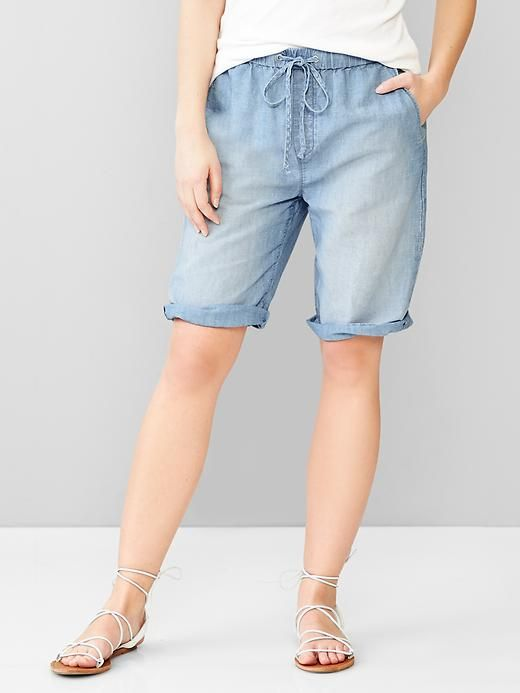 1969 linen denim board shorts | Gap, fabric & care      60% Cotton, 40% Linen.     Machine wash.     Imported.  overview      Premium linen denim.     Light medium blue wash with fading.     Drawcord ties at elasticized waist, faux fly.     Angled pockets in front, patch pockets in back.     Rolled cuffs.