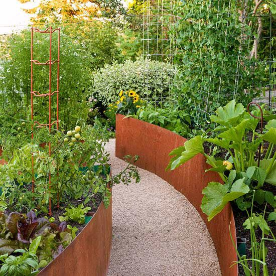 Curved Raised Veggie Gardens - build your raised beds out of galvanized steel or rustic materials.