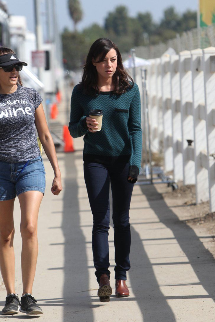 Pin for Later: Parks and Recreation's Ben and Leslie Are Back! . . . in the Future  Aubrey Plaza grabs a cup of coffee on the set.