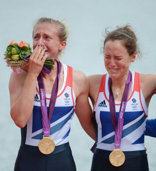 WINDSOR, ENGLAND - AUGUST 04: Katherine Copeland and Sophie Hosking of Great Britain celebrate with their gold medals during the medal ceremony for the Lightweight Women's Double Sculls Final on Day 8 of the London 2012 Olympic Games at Eton Dorney on August 4, 2012 in Windsor, England.