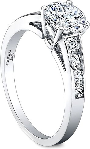 Jeff Cooper Graduated Channel Set Diamond Engagement Ring : This diamond engagement ring setting features graduated round brilliant cut diamonds that are channel set along the shank which accentuates the center stone of your choice.