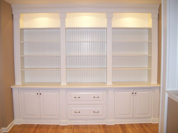 Love the trim details at top and bottom upper lighting is - What did the wall say to the bookcase ...