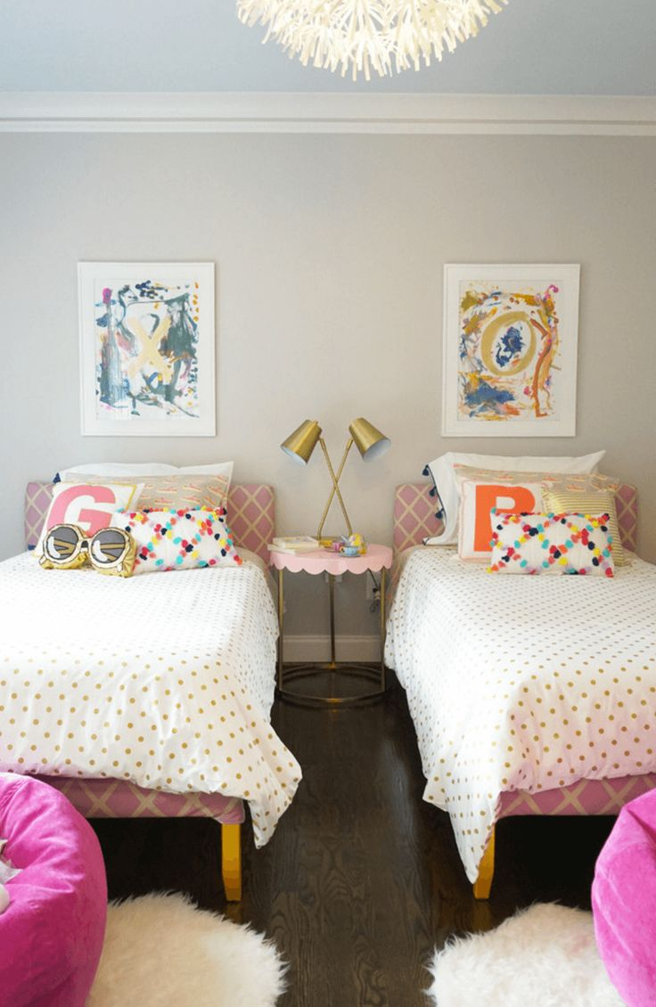 Though the walls are neutral, this room is packed with colors and patterns that pop. Even teenage girls wouldn't mind sharing this room