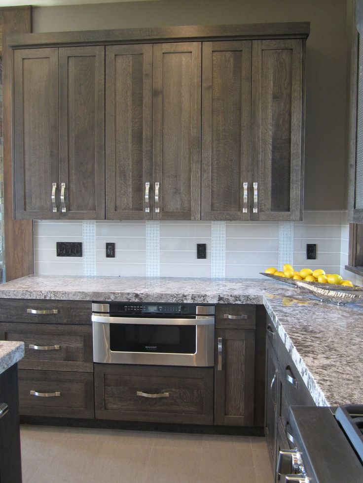 really like the color of the cabinets - would like different backsplash and different hardware - Modern Kitchen