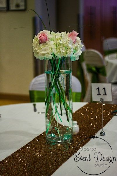 Reception Decor at Winsport Canada Olympic Park - White Hydrangeas, Pink Roses, Bear Grass and Green LED Lights