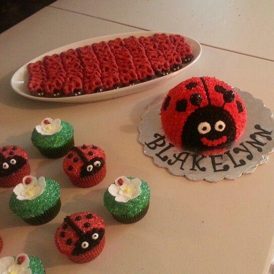 Happy 1st b'day Blakelynn...ladybug smash cake, cupcakes and chochocolate Covered pretzels