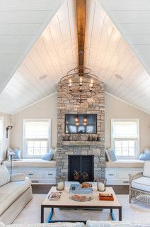 Built-ins around Fireplace. Windows. Rock Fireplace surround. Cool light fixture. Cathedral ceiling.