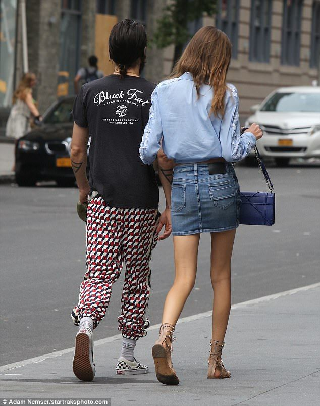 Stayed close: The good-looking pair strolled arm in arm along the Manhattan street