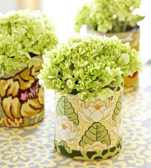 These were discarded paint cans that have been wrapped in fabric - excellent repurposing idea!