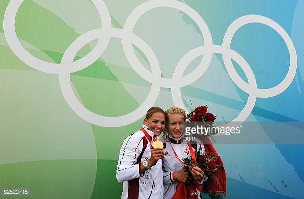 Hungary's Katalin Kovacs and Natasa Janic pose following the medals ceremony after winning the men's canoe double C2 flatwater finals in the 2008...