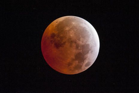 A lunar eclipse is seen on Saturday, April 4, 2015, in Placerville, Calif. Early risers in the western U.S. and Canada should have been able to catch a glimpse before dawn Saturday. The moment when the moon was completely obscured by Earth's shadow lasted only a few minutes, making it the shortest lunar eclipse of the century.
