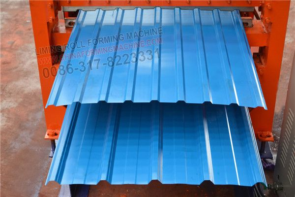 The #double #layer #steel #sheet #roll #forming #machine includes: 7 tons of manual uncoiler,guide platform,roll forming host,cutting device,output table,main motor,encoder,hydraulic station,PLC control system,electronic components.