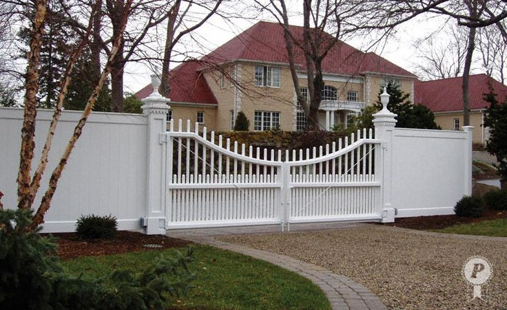 White Vinyl Privacy Fence With Picket Driveway Gate