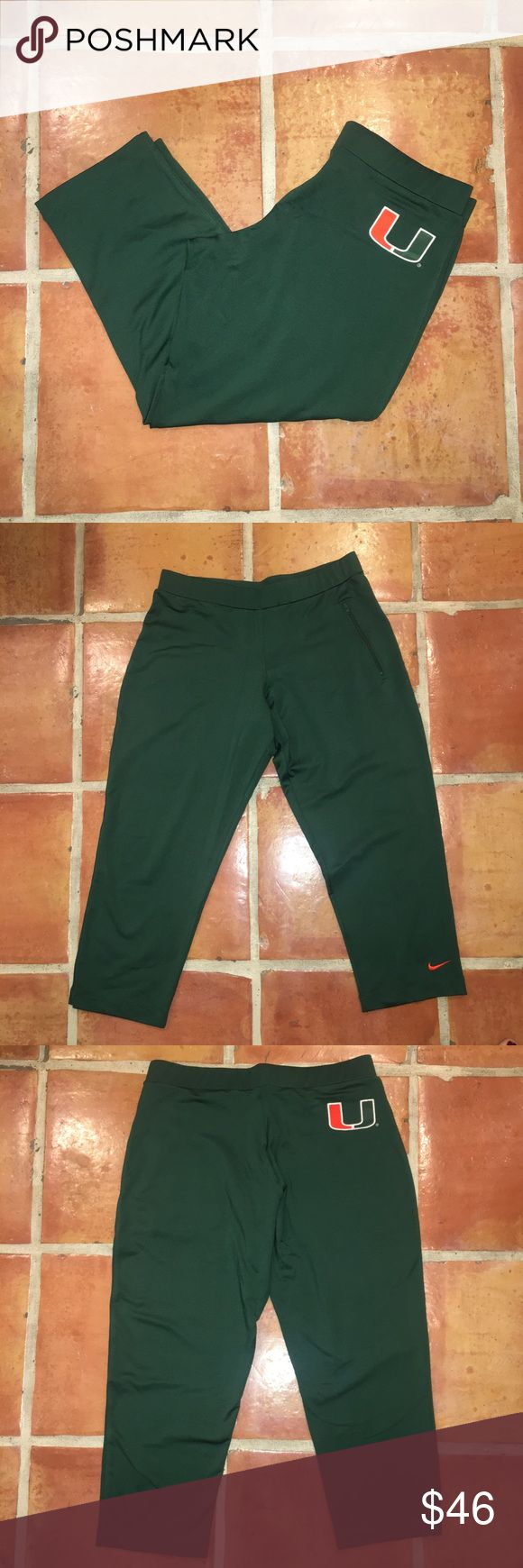 """EUC Nike University of Miami Capri Pants 🙌🏼 Worn once! Has a zipper on the front right side of the pants. Has a U symbol on the back right side. They have an elastic waistband. They are made of 88% polyester and 12% spandex. Size medium (8-10) and they are women's. The width across waist is 15.5"""" with a 23.5"""" inseam. The leg opening is 7"""" across. Feel free to bundle and make an offer. Perfect for any Hurricane fan!! 🙌🏼 Nike Pants Track Pants & Joggers"""