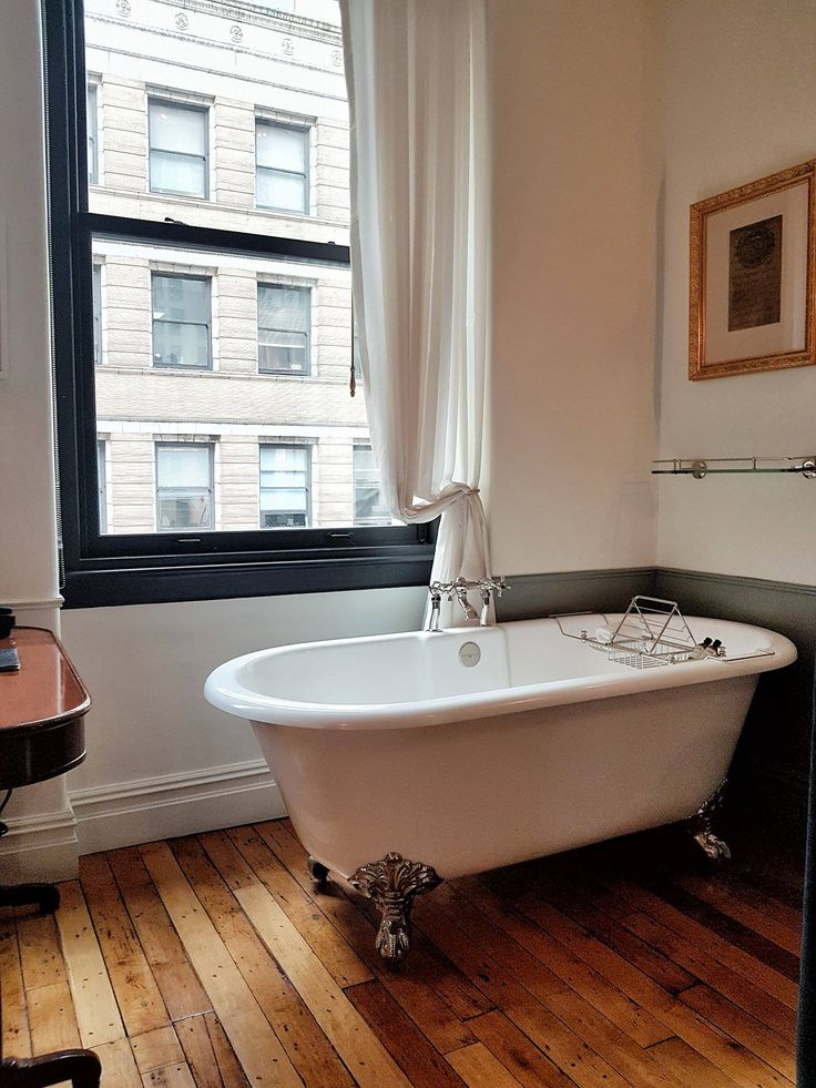 The in-room bathtubs belong to The Nomad Hotel trademarks
