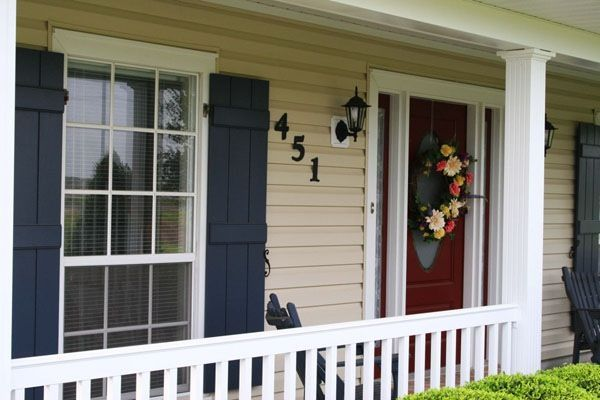 exterior house paint look I am going for...tan/yellow siding, red door, black trim
