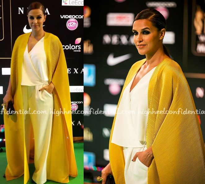 Can always count on Neha Dhupia to deliver on the red carpet (or green) and this latest sighting didn't disappoint either. Instead of an elaborate gown, the actor paired M&S ivory jumpsuit with a cheery yellow Payal Khandwala jacket and the result while minimalist wasn't exactly skimpy on the drama. The voluminous jacket took care …