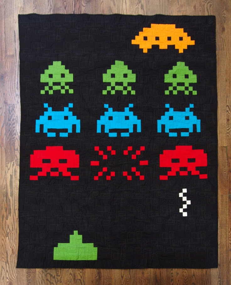 "Erikia's Amazing Space Invaders Quilt ~ "" I made this quilt for my boyfriend because he needed a better blanket for his sofa. I wanted it to be uber cool, so I went on a search for edgy, modern quilts a la Boo Davis. When I came across some Space Invader designs, I knew I found the perfect pattern."""