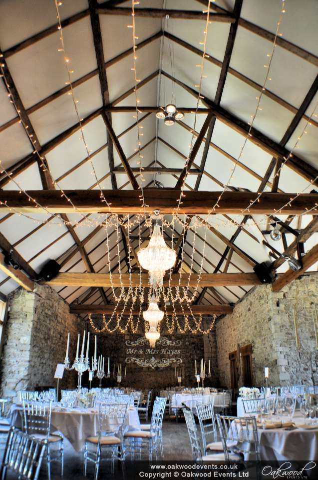 Double gather fairy light canopy by Oakwood Events at Notley Abbey, a beautiful barn wedding venue by Bijou