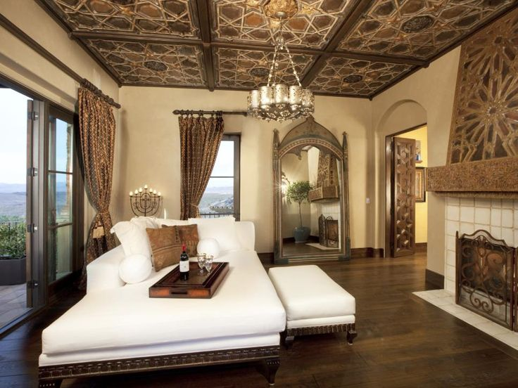 Just off the master bedroom, this sanctuary room is truly a unique in-house getaway. The most dramatic and eye-catching feature of the room is undeniably the ornate, hand-carved reclaimed ceiling from Ecuador. Venetian plastered walls in a fresh ivory hue serve as a soft complement to the ceiling detail and reclaimed ash wood flooring. Mirroring the elaborate ceiling designs, designer Lori Venners added a custom sake wood hearth as a welcoming accompaniment to a simple tiled fireplace. No…