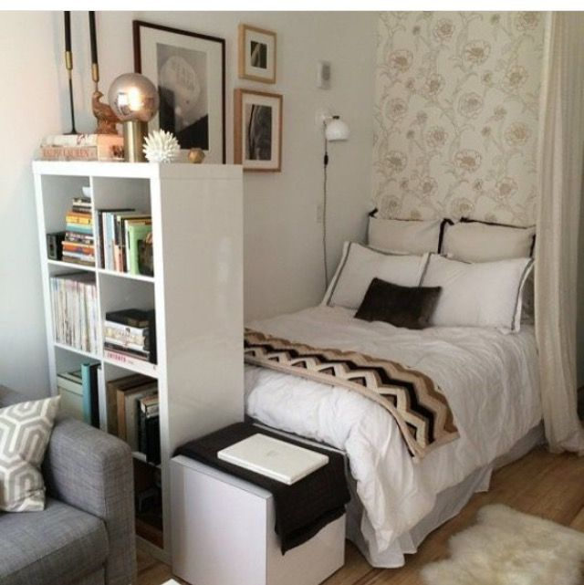 Save space by putting the bed in a corner and use a bookcase as a room divider!