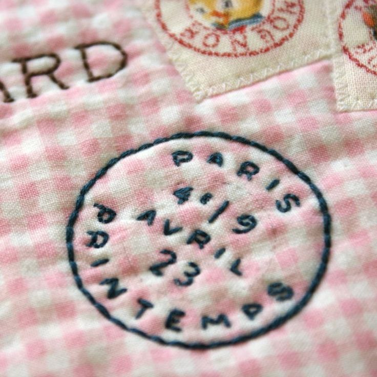 Great way to name or date a quilt: embroidered postal cancellation. Label