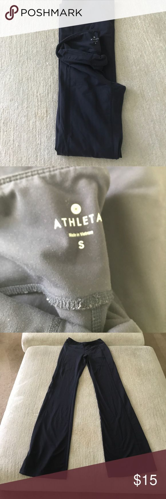 Athleta boot cut navy yoga pants Worn 2 times just too long on me for yoga - for all you tall people! Super soft great breathing material a top brand for work out or running errands - boot cut makes them even good for wearing out! Athleta Pants Leggings