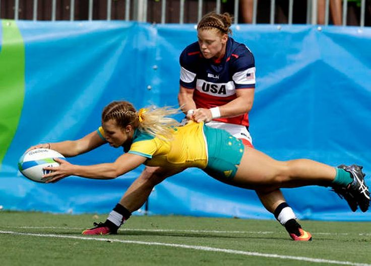 Australia's Emma Tonegato, front, scores a try as USA's Alev Kelter, tries to defend during the women's rugby sevens match at the Summer Olympics in Rio de Janeiro, Brazil, Sunday, (960×690)
