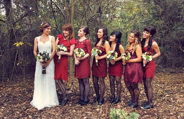 Mix and match red bridesmaids dresses. (Really not convinced about those stockings, though.)