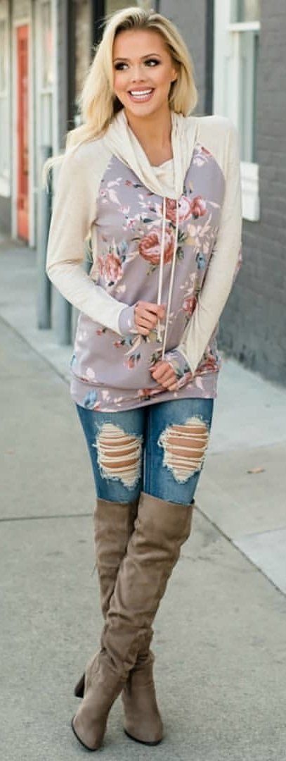 #spring #outfits woman wearing purple and white floral pullover hoodie, blue denim distressed jeans and beige thigh high boot outfit. Pic by @shopmvb #bootsoutfit #kneehighbootsoutfit