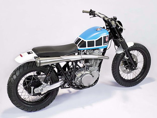 Jens vom Brauck and Kedo, the German tuning and parts specialists, have taken an everyday Yamaha SR500 and gone back to the roots. The bike looks lean, mean and low—a mutant cross between a 60s desert racer and Kenny Robert's flat track bike. It has a raw competition look, with black rims, a machined alloy…