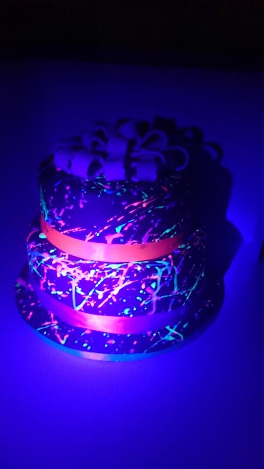 Neon splatter cake glows under black light