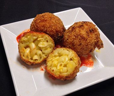 At Boston's Local 149, you can order fritters—mac and cheese balls coated in bread crumbs, fried, and served up with spicy ketchup.