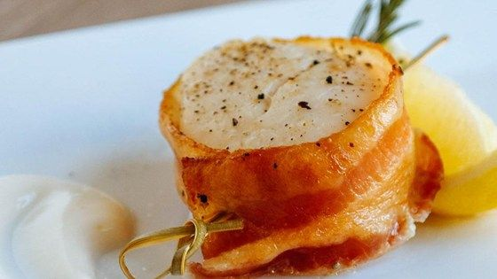 Baked scallops wrapped in bacon and drizzled with lemon juice.