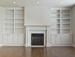 Mantles & Fireplaces - Really like the storage idea here. Maybe single shelf on each side of fireplace?