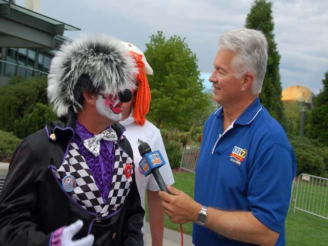 Reporter Chris Legeros interviews a Seafair clown: Chris Legero, Legero Interview, Reports Chris