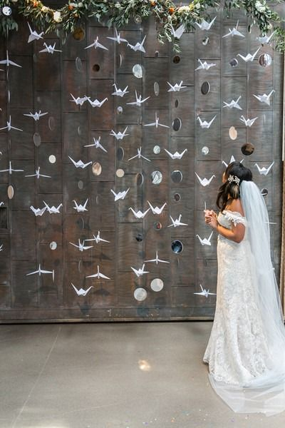 Modern wedding ceremony decor idea - unique wedding ceremony backdrop - hanging origami cranes and mirrors {Dawn E. Roscoe Photography}