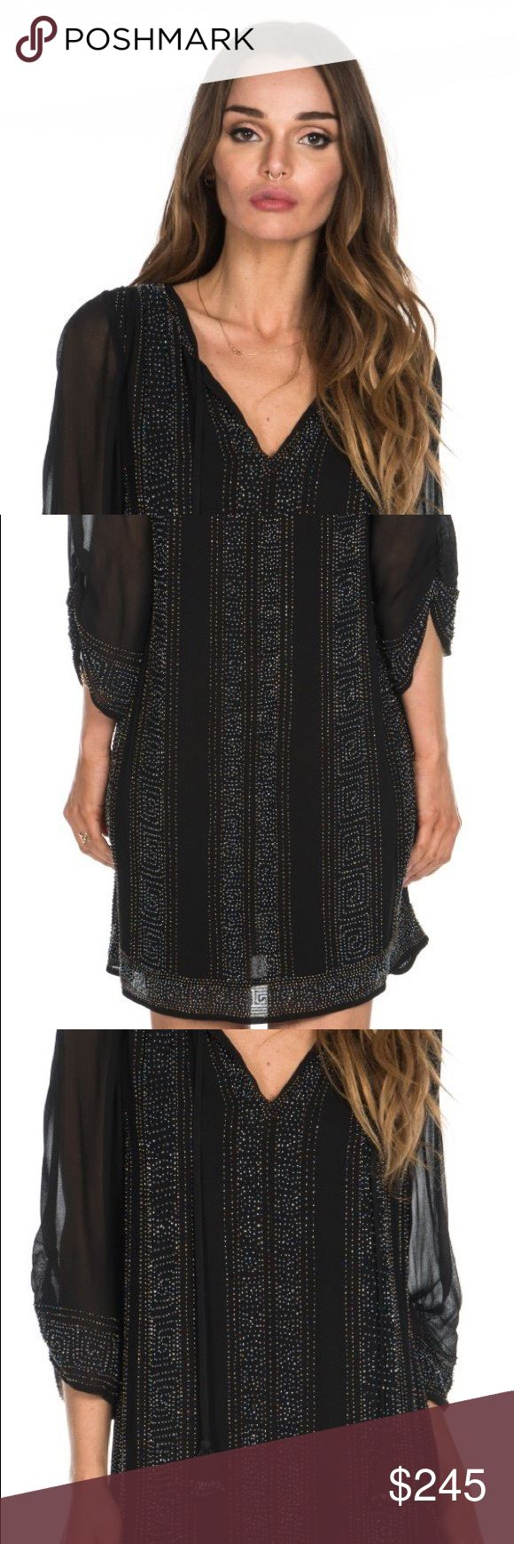 Tolani Vixi black tunic dress Tolani tunic dress with a million beads plus extra! Never worn, brand- new, perfect condition, gorgeous dress. The beads are tiny and dainty and all different colors- look iridescent when light captures! Tolani Dresses