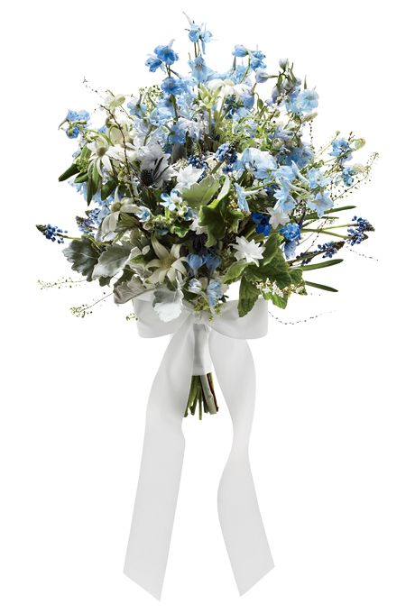 Brides.com: . A Beachy Wedding Bouquet with Blue Delphiniums. We love this breezy blue bouquet for an ocean-side ceremony. Pops of white keep it bright and cheerful.   Delphinium, tweedia, and muscari wedding bouquet, $250, The Designers' Co-op  See more delphinium wedding flowers.