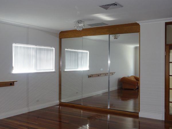 Frameless Mirror Sliding Doors In Wooden Frame