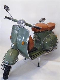 Vespa VBB scooter circa 1964 in vintage sage green finish, tan saddle seat and rear square seat. Restored in Vietnam and imported to the UK