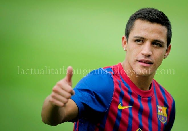 Barcelona's Chilean new player Alexis Sanchez gives a thumb up during his official presentation after signing a new contract with the Catalan club on July 25, 2011, at the Sports Center FC Bacelona Joan Gamper, in San Juan Despi, near Barcelona. AFP PHOTO / JOSEP LAGO (Photo credit should read JOSEP LAGO/AFP/Getty Images)
