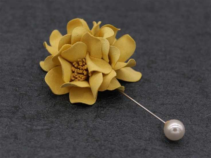 Classy Yellow Lapel Flower: The rose flower of the lapel pin is made with a classy shade of yellow with the stigmas that are placed in the center, made in dark yellow fabric. This relatively smaller flower has a silver pin attached to it with a white bead on the other end. bowselectie.com