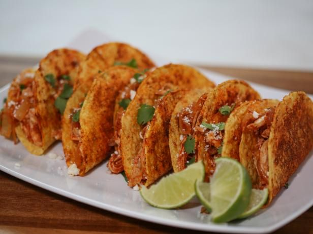 Get Pulled Chicken Tacos with Seasoned Taco Shells Recipe from Food Network