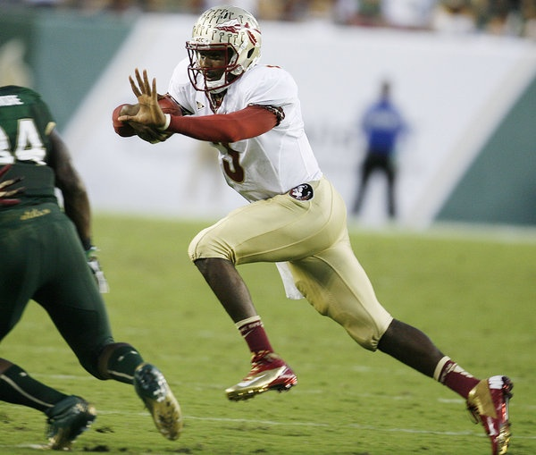 FSU quarterback E.J. Manuel runs during the FSU at USF college football game at Raymond James Stadium in Tampa.