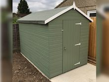 Sage green painted garden shed for storage of furniture and tools. The Tiger Shiplap Windowless Apex Shed is perfect for keeping prying eyes out | Apex Shiplap Sheds | Tiger Sheds
