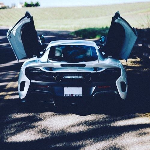 Wings up on the McLaren #cars #car #ride #drive #driver #sportscar #vehicle #vehicles #street #road #freeway #highway #sportscars #exotic #exoticcar #exoticcars #speed #tire #tires #spoiler #muffler #race #racing #wheel #wheels #rim #rims #engine #horsepower