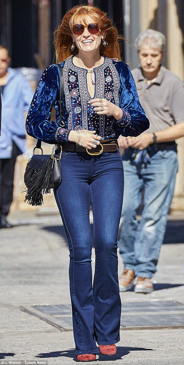 Retro style: Florence Welch showed off a '70s-inspired look as she strolled around the Eas...
