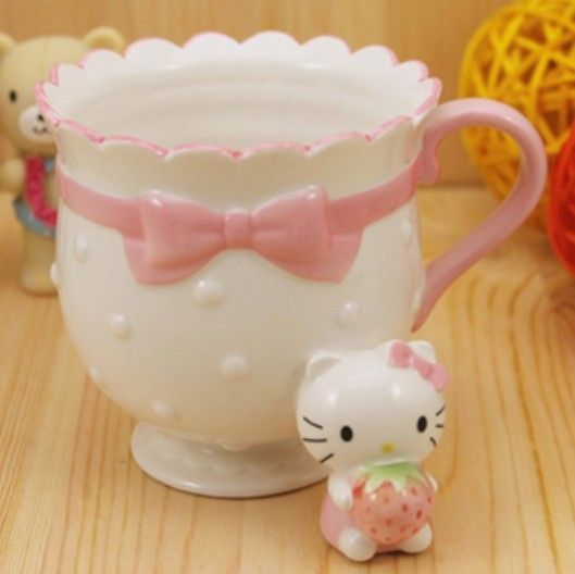 Hello Kitty Princess Coffee Mug - Hello Kitty Mugs - Hello Kitty Stores and like OMG! get some yourself some pawtastic adorable cat apparel!
