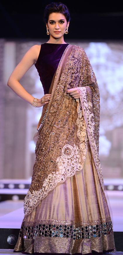 Kriti Sanon displays a gorgeous designer lehenga at a fashion event. Source: Rediff.com